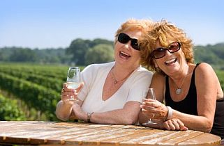Mature women celebrating with a birthday wine tour
